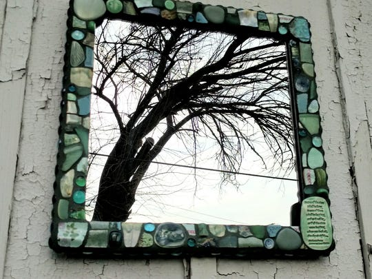 Artist Jessica Kortz used handmade ceramic pieces and found objects to create this mirror.