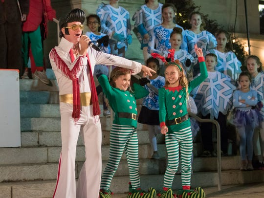 Elvis performs during the opening ceremony in Plaza Wonderland following the annual Elf Parade in downtown Pensacola on Friday, November 24, 2017.