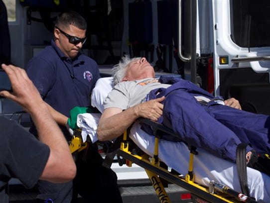 """""""Mad"""" Mike Hughes is carried on a stretcher after his"""