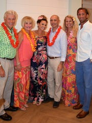 Dr. John and Marlene Cairns, left, Dr. Phil and Julie Cromer and Katie and Eric Smith at the 41st annual Tropical Night Luau to benefit the Youth Guidance Mentoring Academy.