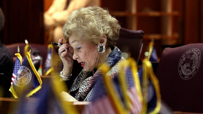 The final day of the legislative session made for busy lawmakers in the house and senate chambers Wednesday, March 14, 2018. Rep Shelia Klinker works on signing papers during final day of the legislative session.