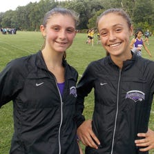 Bloomfield Hills junior Giovanna Leone (left) and freshman teammate Christina Hickson placed among the top five Tuesday at the first OAA White Division Jamboree in Royal Oak.
