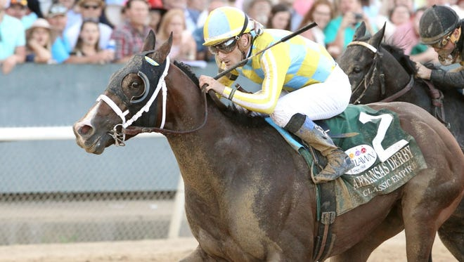 Classic Empire and jockey Julien Leparoux win the Arkansas Derby at Oaklawn Park.
