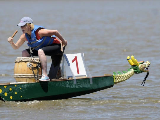 Miles of Hope board member Mary Ritter guides her boat on the Hudson River during the 2014 Dragon Boat Race and Festival in Poughkeepsie.
