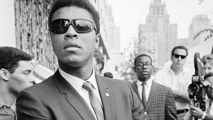 Heavyweight champion Muhammad Ali stands outside the federal courthouse in Houston following a hearing on an injunction to keep him out of the Armed Forces.