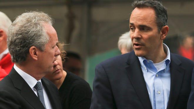 Mayor Greg Fischer, left, talks with Matt Bevin after a Veterans Day Parade in Louisville.