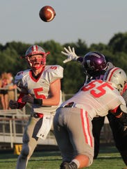 Shelby quarterback Brennan Armstrong throws a pass