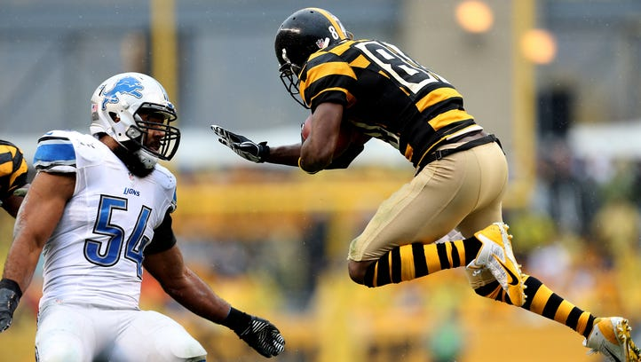Detroit Lions linebacker DeAndre Levy, left, tackles the Pittsburgh Steelers' Antonio Brown during on Nov. 17, 2013, at Heinz Field in Pittsburgh.