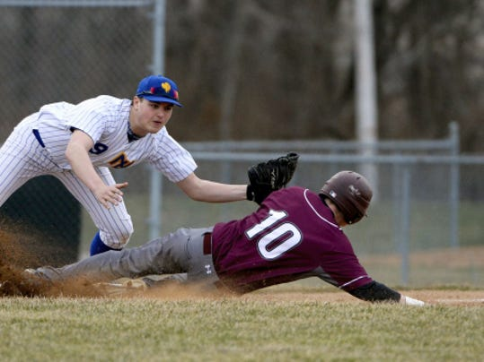 Northern Lebanon's Seth Walmer can't hold onto the ball as Manheim Central's Peter Breit slides safely into third base during a regular-season game in Manheim on Thursday. Northern Lebanon fell, 8-2.