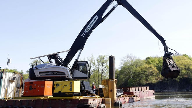 In this May 2015 file photo, crews perform dredging work along the upper Hudson River in Waterford.