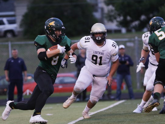 D.C. Everest;s Tanner Fowler heads up field for a short