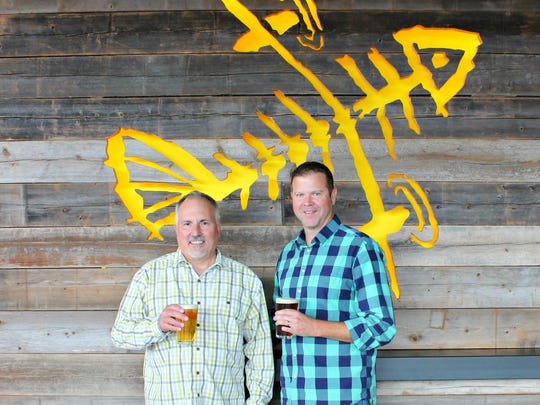 Flying Fish Founder Gene Muller, left, and President Lou Romano stand in the brewery in Somerdale.