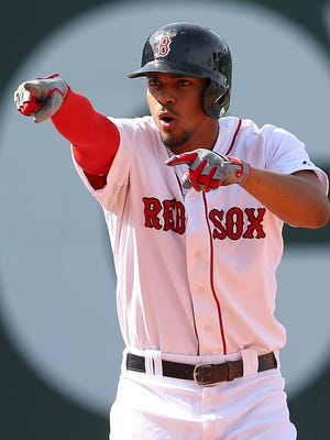 Xander Bogaerts reacts after his go-ahead eighth inning double Sunday at Fenway Park.