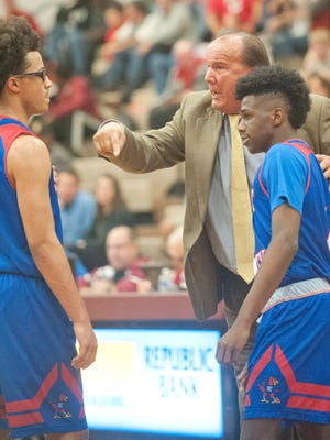 Scott County head basketball coach Billy Hicks talks to his players Lorenzo Williams, left, and Cam Fluker during their game at Ballard on Dec. 1.