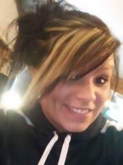 Alyssa Whitcomb, 22, has a diamond piercing below her