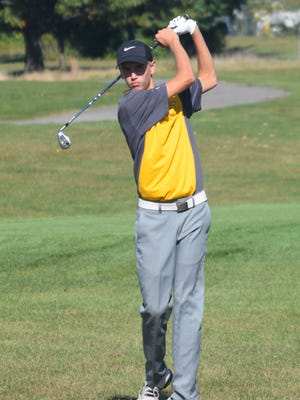 Watkins Memorial sophomore Cody Codgill watches his shot Tuesday during the Division I sectional tournament at Turnberry. Codgill shot 78 to qualify for the district.