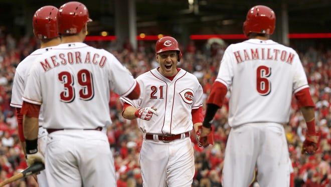 Reds third baseman Todd Frazier (21) celebrates his three-run home run in the eighth inning to give the Reds an Opening Day win over the Pittsburgh Pirates.