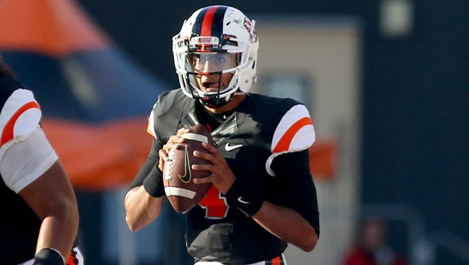 Oregon State quarterback Seth Collins (4) drops back to pass against Weber State during the first half at Reser Stadium, Friday, September 4, 2015, in Corvallis, Ore. The Beavers won the game 26-7.