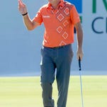 Brian Gay acknowledges the crowd after rolling in a long birdie putt on the 17th hole.