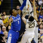 Kentucky's James Young (1) defends against Wichita State's Fred VanVleet (23) during the first half of an NCAA tournament game on Sunday in St. Louis.