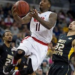 Central Missouri's Daylen Robinson, center, drives past West Liberty's Kelvin Goodwin, left, and former Zanesville standout Cedric Harris during Saturday's Division II championship in Evansville, Ind. Harris finished with 18 points, including 14 in the second half.