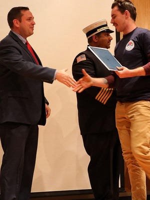 Orange County Executive Steven M. Neuhaus congratulates Washingtonville firefighter Michael Alsdorf at the County's Firefighter 1 graduation ceremony on Dec. 18 at the Emergency Services Center in Goshen.