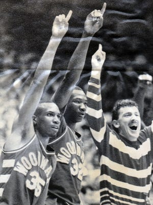 MARCH 27, 1988: Woodward's Troy Long (35), Chip Jones (32) and assistant coach Jimmy Leon celebrate during final seconds of state title game against Columbus Linden McKinley.