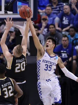UK's Derek Willis (35) blocks a shot by Wichita's Rauno Nurger (20) during the NCAA tournament at the Bankers Life Fieldhouse in Indianapolis.Mar. 19, 2017