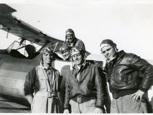 636463781571696599-Moorehead-Phillips-right-and-others-with-Stearman-biplane-during-flight-training-1943..jpg
