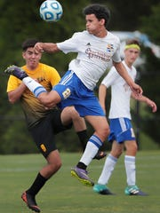 Gatlinburgh-Pittman's Ricardo Turcois tries to control the ball in the air under pressure by MBA's Agustin Fernandez during the Class A boys soccer quarterfinals at Spring Fling in Murfreesboro.