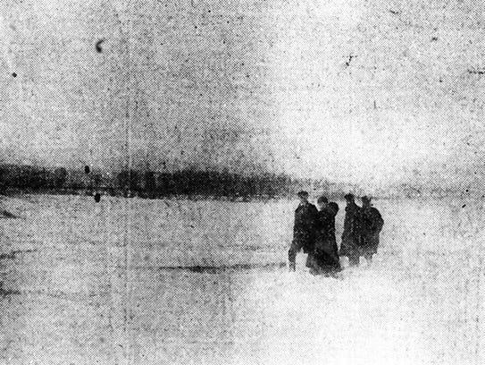 People walk across the frozen Ohio River in Evansville,