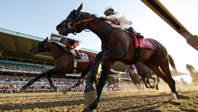 Tonalist (11), with Joel Rosario up, crosses the finish line ahead of Commissioner (8), with Javier Castellano up, to win the Belmont Stakes horse race, Saturday, June 7, 2014, in Elmont, N.Y. (AP Photo/Matt Slocum)