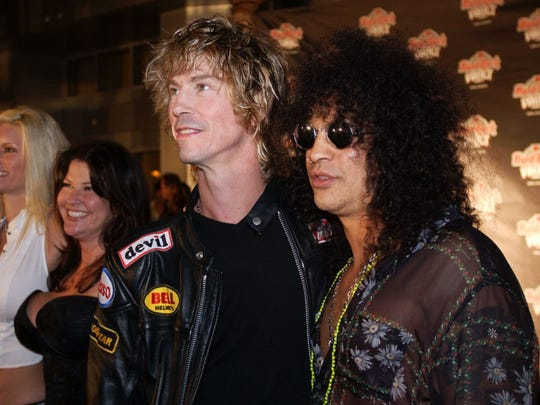 Guns N' Roses bassist Duff McKagan (center) and guitarist Slash are back in the band for the first time in two decades.