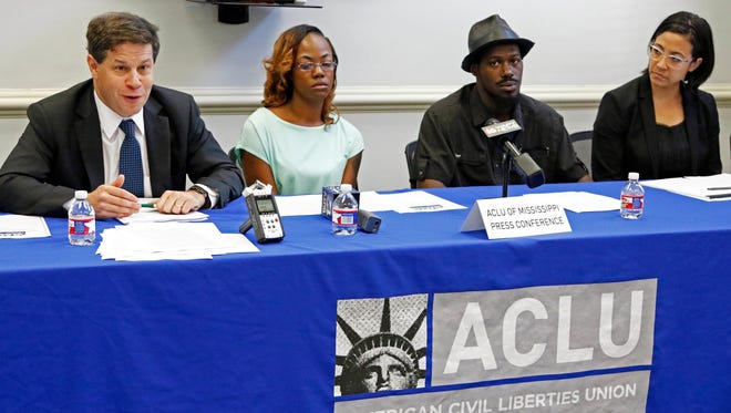 Attorney Jonathan Youngwood, left, co-counsel with the ACLU of Mississippi, discusses Monday at a news conference in Jackson a lawsuit filed on behalf of 10 plaintiffs suing the Madison County Sheriff's Department over what they believe are unconstitutional policing policies of black residents in the Jackson suburb. Seated next to him are Quinnetta Manning, second from left, and Steven Smith, both plaintiffs from Madison County, and attorney Paloma Wu, legal director of the ACLU of Mississippi, right.