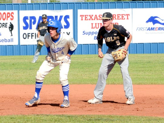 Carlsbad's Garret Day looks to advance to third base in game one Friday against Hobbs.