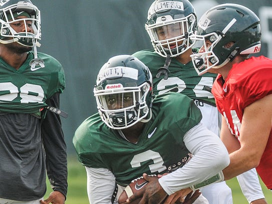 MSU running backs Madre London, (28) and Gerald Holmes,