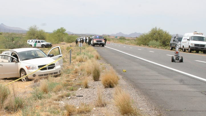 In this file photo, a car containing the bodies of