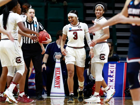 South Carolina guard Destanni Henderson (3) smiles after being fouled while facing Belmont in a first-round game in the NCAA women's college basketball tournament in Charlotte, N.C., Friday, March 22, 2019. (AP Photo/Jason E. Miczek)