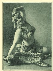 """This image provided by the The Historic New Orleans Collection shows an undated photo of Rita Walker from Blue Book, one of the pocket-sized directories of New Orleans prostitutes published more than a century ago. Pamela Arceneaux, author of """"Guidebooks to Sin: The Blue Books of Storyville, New Orleans,"""" says it's the ads for brothels, saloons, liquor brands and hangover cures that make the booklets so interesting."""
