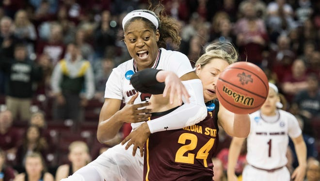 South Carolina guard Kaela Davis, left, battles for a rebound against Arizona State forward Kelsey Moos (24) during a second-round game in the NCAA women's college basketball tournament Sunday, March 19, 2017, in Columbia, S.C.