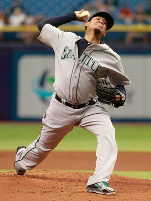 Felix Hernandez pitched a four-hitter to become the major's first eight-game winner.