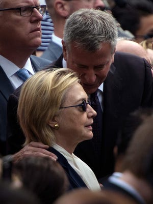 New York City Mayor Bill de Blasio speaks to US Democratic presidential nominee Hillary Clinton during a memorial service at the National 9/11 Memorial.