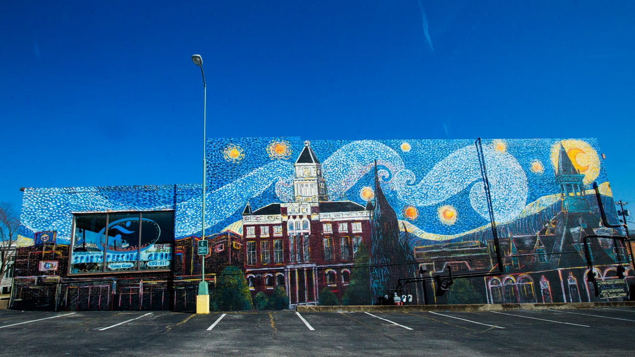 On Thursday, community members gathered outside of 420 Madison St. to celebrate the completion of Clarksville's Starry Night mural, by artist Olasubomi Aka-Bashorun.