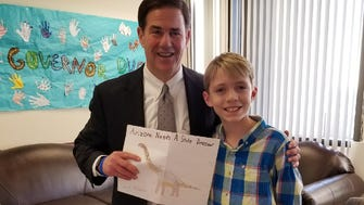 Jax Weldon, 11, meets with Gov. Doug Ducey. Jax wrote to the governor in October about making the Sonorasaurus the state dinosaur.