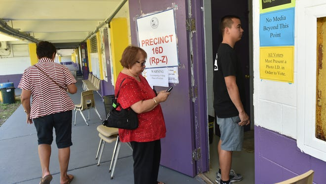 Voters show up for Primary Election Day at George Washington High School in Mangilao on Aug. 27.