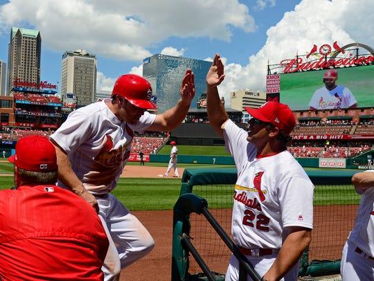 Cardinals pinch hitter Chad Huffman is congratulated
