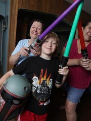 """""""Star Wars"""" fans in Waldwick: Elaine Senft, her daughter Kimberly Vogt and Kimberly's son Adam Vogt, 7, with Adam's """"Star Wars"""" toys."""