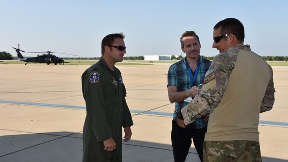 FLORIDA TODAY reporter Rick Neale interviewing two Pave Hawk HH-60 pilots with the 920th Rescue Wing on the tarmac at Easterwood Airport in College Station, Texas.