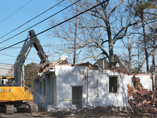 Workers demolish old gatehouse to State Game Farm Road that has long been in disrepair and  an eyesore according to members of the neighboring Forked River Presbyterian Church and has hurt the church's ability to recruit new members. Photo taken on March 29, 2016 in Lacey Township.