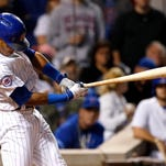 Russell's 2-run single lifts Cubs over Giants